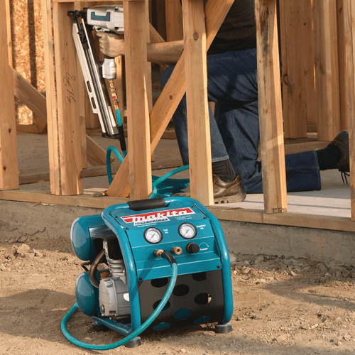 image showing the makita mac2400 big bore air compressor being used with a nailer