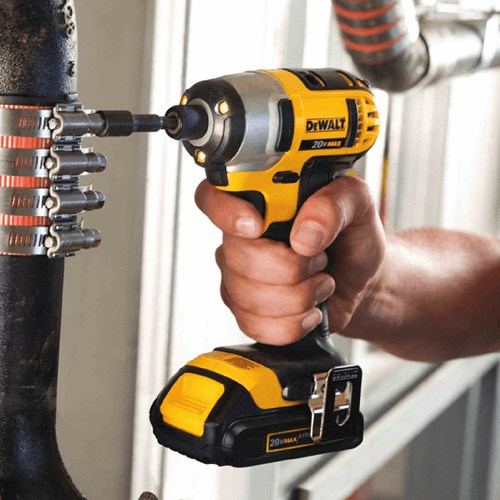 an image showing the dewalt dcf885 impact driver in use
