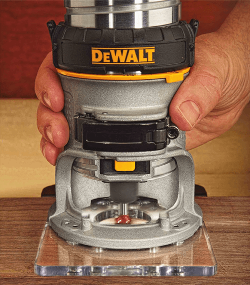 an image of the dewalt dwp611 compact router in use one handed