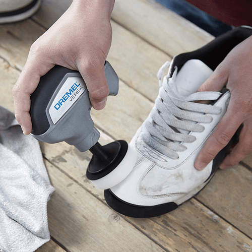 an image showing the dremel versa power cleaner in use cleaning shoes