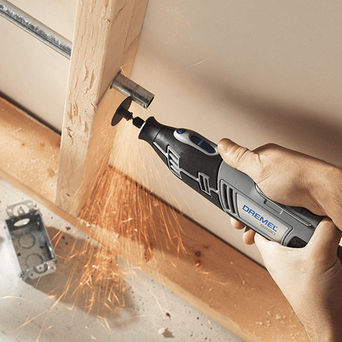 an image showing the cordless dremel 8220 rotary tool in use cutting