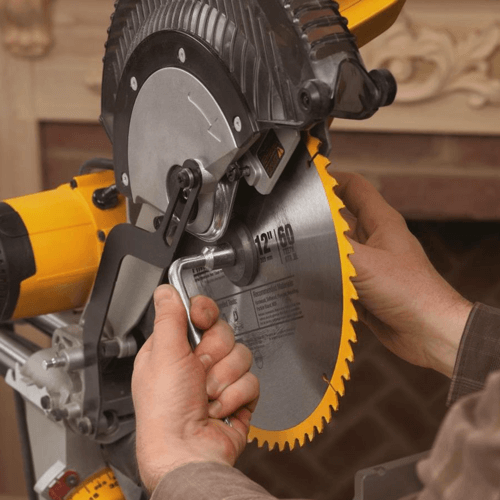 image showing the blade being changed on a dewalt miter saw