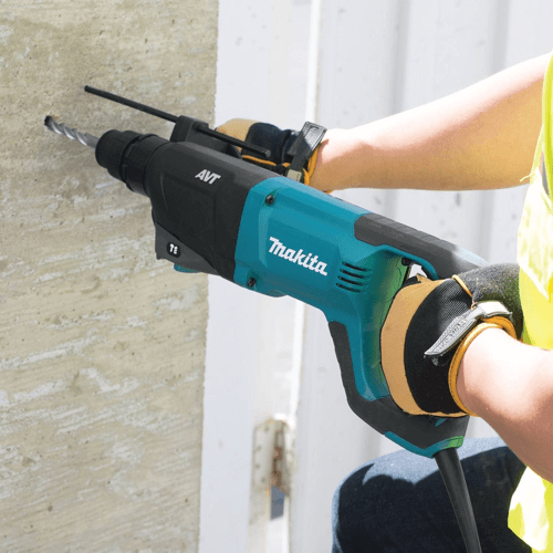 an image showing a makita hammer drill in use
