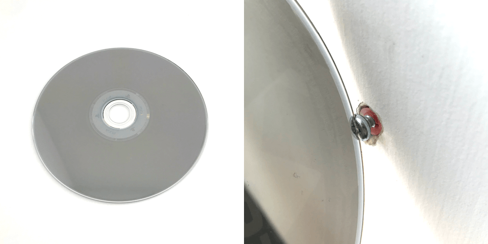 an image showing a CD being used to unscrew a screw