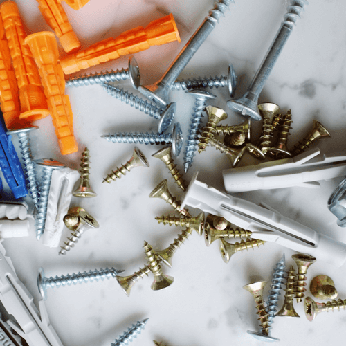 an image showing an assortment of different screw sizes. Choosing a larger screw is one method of how to fix a screw hole that is too big