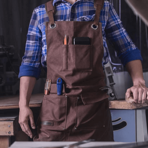 image of a waxed canvass heavy duty shop apron with pockets