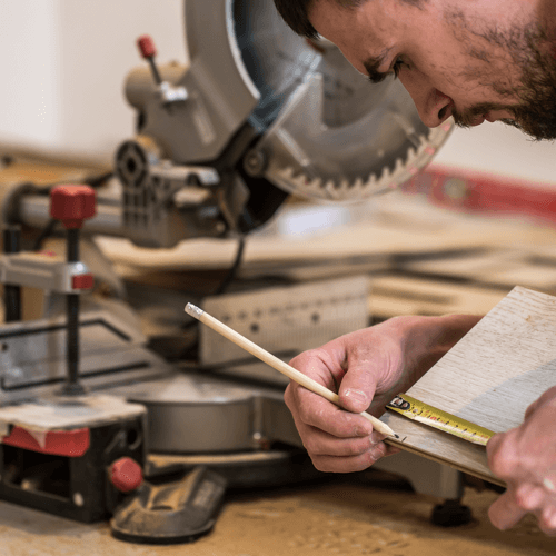 an image showing wood being marked prior to being cut by a miter saw