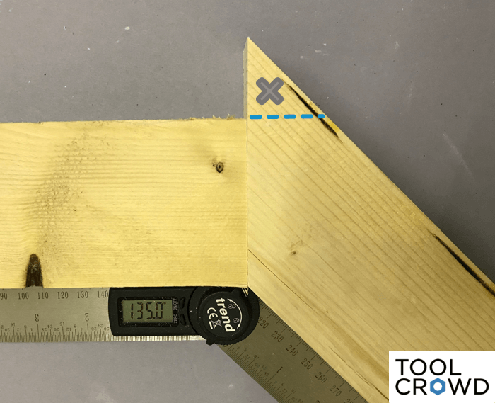 an image showing both a 90 and 45 degree angle cut on a miter saw combined to equal a 135 degree angle overall