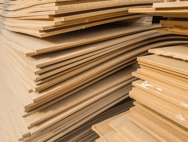 an image showing warped and sagging mdf that hasn't been stored correctly - one example from our article on how to stop mdf warping