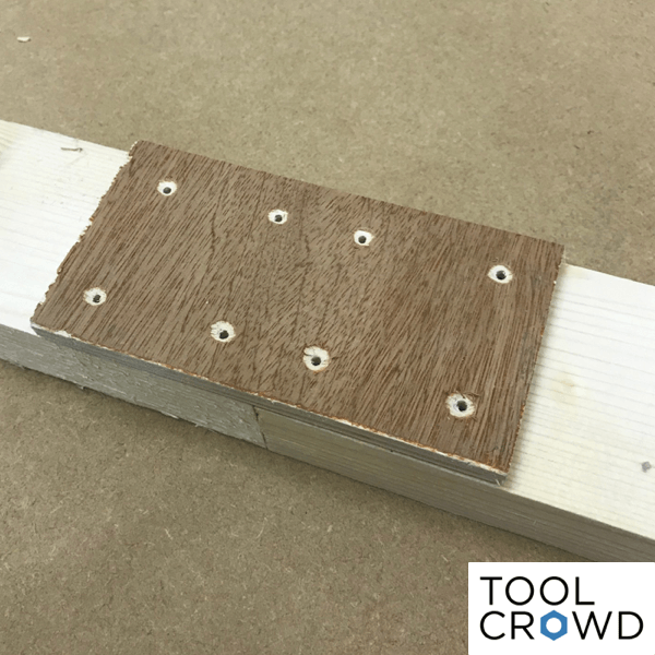 image showing drilled strap used to join wood together