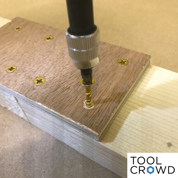 image showing wood joined together with screws and strap