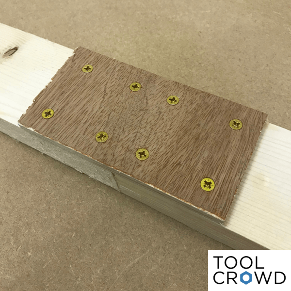 image showing wooden strap used to join two pieces of wood with screws