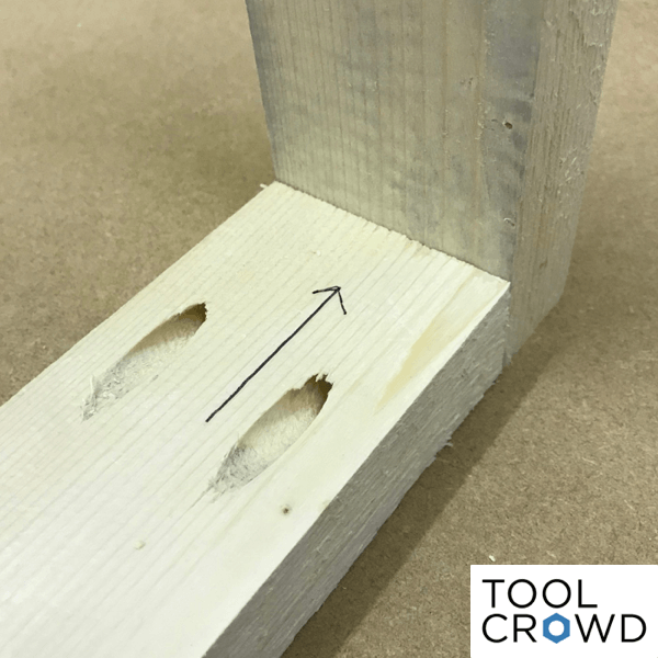 an image showing two pieces of wood joined together using pocket hole screws