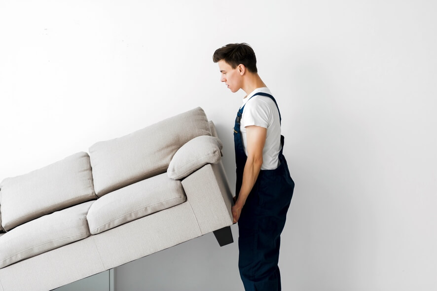 how to remove laminate flooring without damage - an image showing furniture being removed from a room