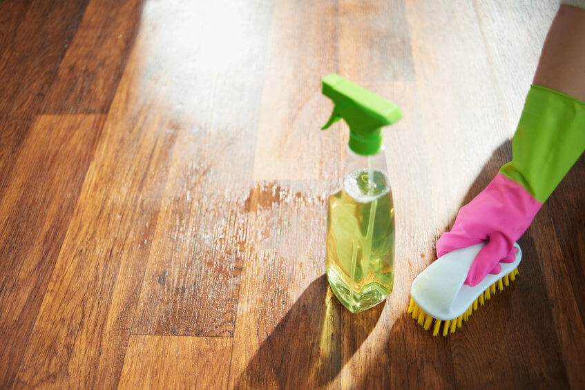 why is hardwood flooring so popular article image - an image showing a hardwood floor being cleaned easily